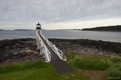 Marshall Point Light sits on the point at the end of a long walkway outside of Port Clyde, Maine.