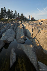 The Pemaquid Point Light sits above a rocky shoreline in northeast Maine.