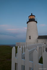 Pemaquid Point Light is lit by the last light of the day in northeast Maine.