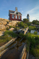 The bellhouse at Pemaquid Point Light is reflected in a pool in northeast Maine.