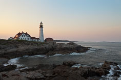 The last light of the day illuminates Portland Head Light outside of Cape Elizabeth, Maine.