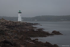 The Fort Constitution Light stands along the shore of the Piscataqua River in Portsmouth, Maine.