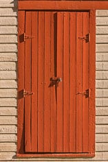 A bright red shuttered window in the ghost town of St. Elmo in central Colorado.