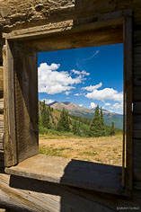 Mt. Elbert and Mount Massive are visible through a window in an old mining building high above Granite, Colorado.