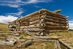 An decrepit old log home sits high above Granite, Colorado.