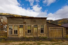 The skies begin to clear over a dampened old building in the ghost town of St. Elmo in central Colorado.