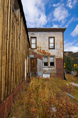 The skies begin to clear over a dampened old rusty building in the ghost town of St. Elmo in central Colorado.
